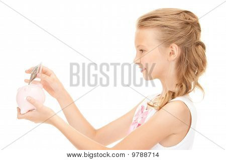 Lovely Teenage Girl With Piggy Bank And Money