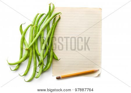 the green beans and blank sheet paper
