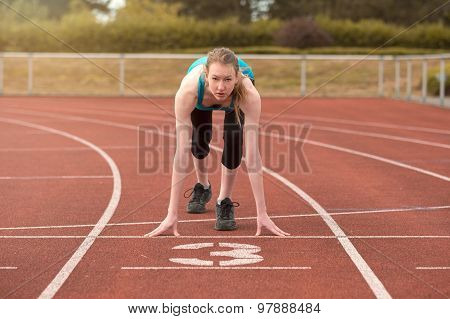 Young Woman Sprinter In The Starter Position