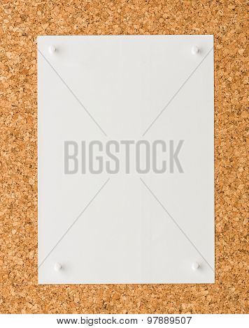 White Paper Note Sheet With White Push Pin On Cork Board
