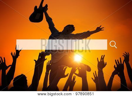 Silhouette of a Young Man Performing in Front of the Crowd