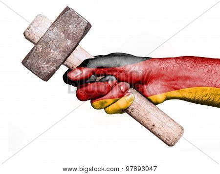 Hand With Flag Of Germany Handling A Heavy Hammer
