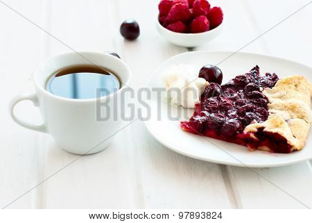 Biscuit With Cherries And A Cup Of Coffee