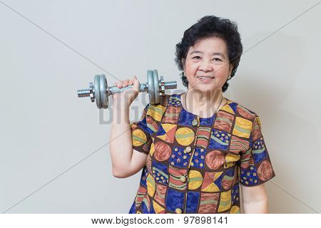 Strong Asian Senior Woman Lifting Weights, In Studio Shot, Specialty Tones