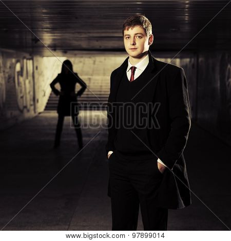 Young handsome business man in underground tunnel