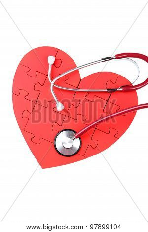 Red Puzzle Heart With Stethoscope Isolated On White