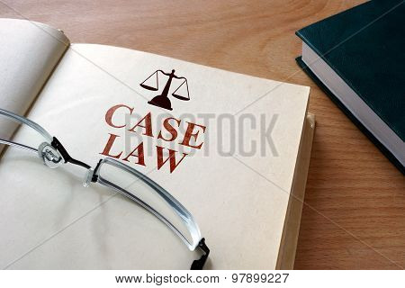 Notepad with words  case law.
