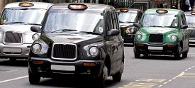 picture of hackney  - Five London Taxi Cabs in Canary Wharf - JPG