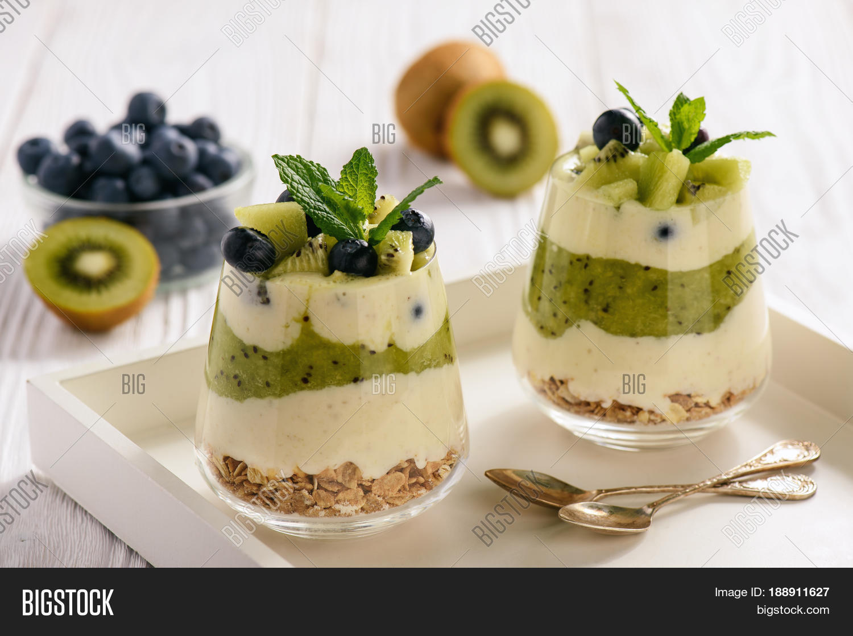 healthy food layered dessert with yogurt muesli kiwi
