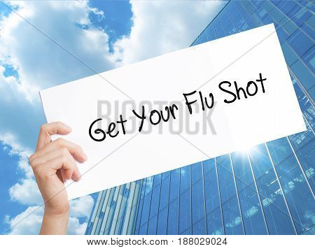 Get Your Flu Shot Sign On White Paper. Man Hand Holding Paper With Text. Isolated On Skyscraper Back