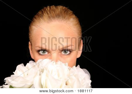 Bride With Her Face Covered By Her Bridal Bouquet