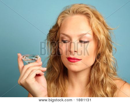 Woman Gazing At A Large Diamond