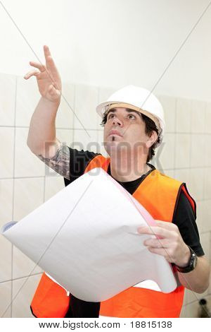 Engineer checking blueprint