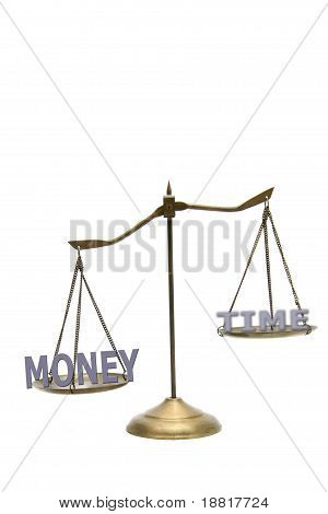 Money Is Greater Than Time Concept On Golden Brass Scales