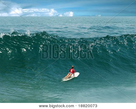 Young girl surfing on Malibu Beach, California