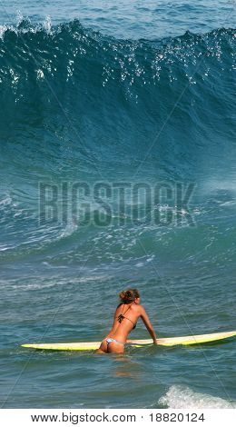 Yong girl ready for surfing on Ipanema Beach in Rio De Janeiro, Brazil