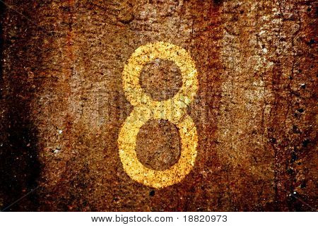 Old rusty metal with number 8