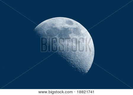 Blue high detailed moon in a blue sky