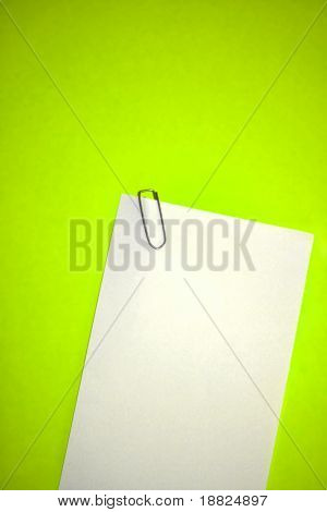 Blank paper on green background