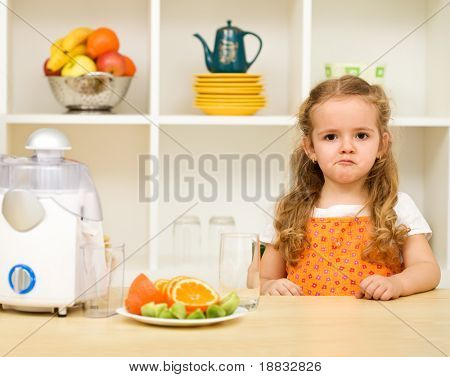 Little girl making faces asking - fruit juice again and no junk food ?