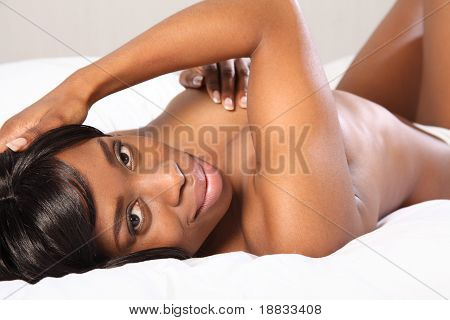 Happy Beautiful Black Woman Topless In Bedroom