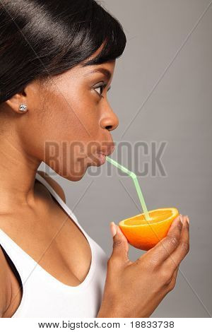 Beautiful African American Woman With Orange Fruit