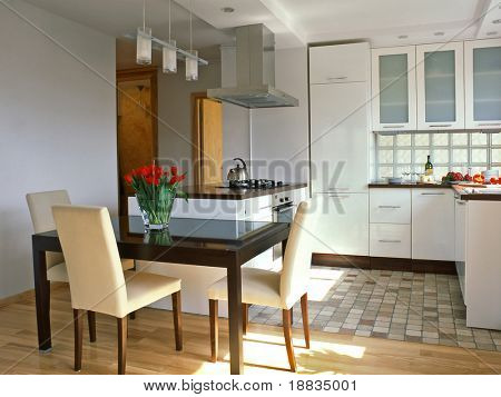 white kitchen with place to eat