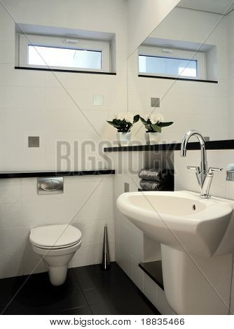white restroom with big mirror
