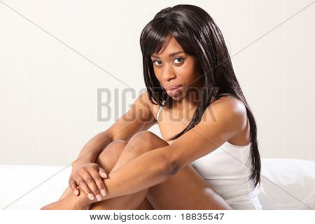 Sexy African American Woman Sitting In Bed