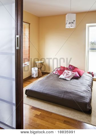 inside of modern bedroom in apartment