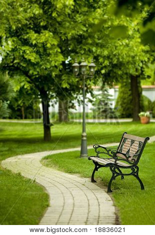 romantic bench in peaceful park in spring