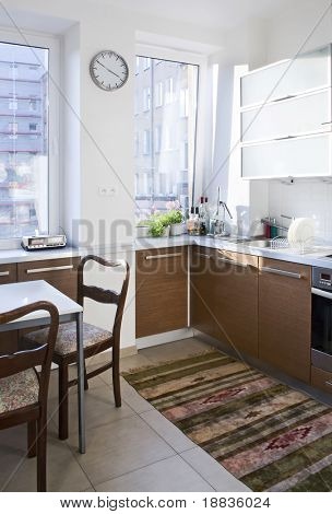 small kitchen with table and chairs