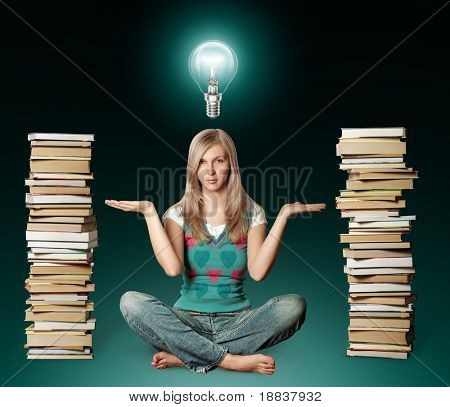 woman in lotus pose with many books near and bulb