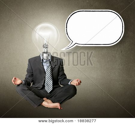 businessman in lotus pose and lamp-head with thought bubble