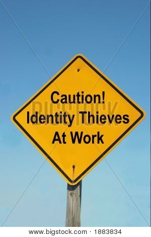 Caution Sign - Identity Thieves At Work