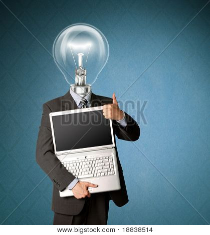businessman with lamp-head with open laptop shows welldone