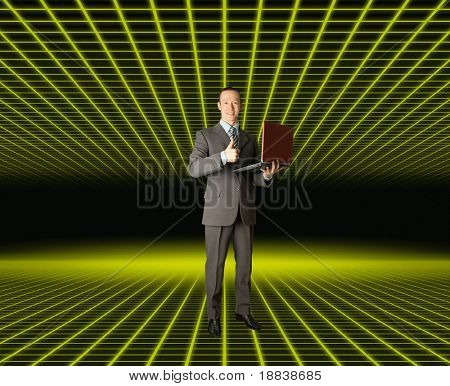 Full length portrait of businessman with laptop, showing welldone, in fantastic place