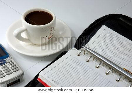 Cup of black coffee cellphone and a laptop business conceptual still-life