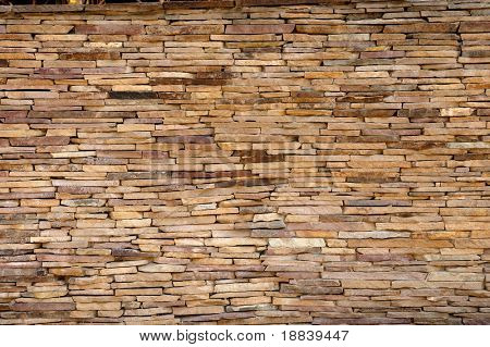Yellow tile cladded stone wall texture architectural background