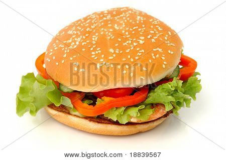 Big appetizing hamburger with vegetables close-up isolated junk food on white background