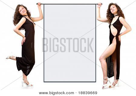 Smiling attractive businesswomen holding blank advertising banner  isolated on white