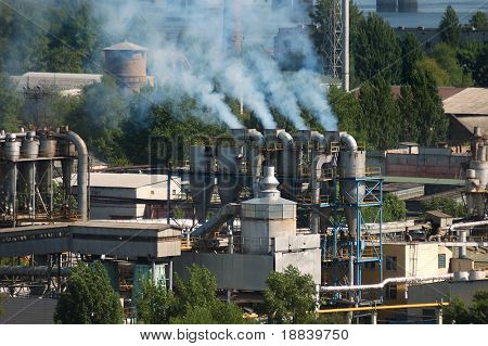 Factory chimney pipes polluting the air with smoke