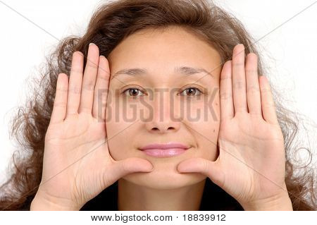 Young happy beautiful woman showing her palms isolated on white background
