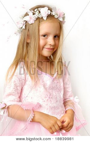 Little cute girl in beautiful pink dress isolated on white background