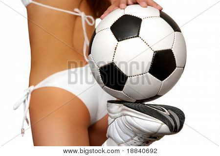 Girl in bikini with soccer ball isolated with clipping path on white