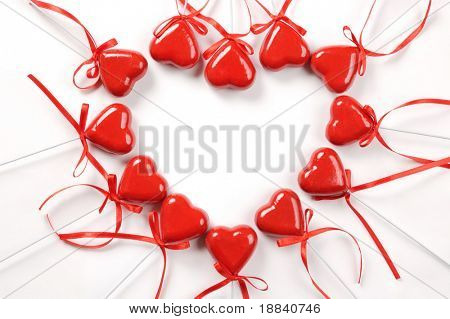 Conceptual heart-shaped pattern made from red hearts Valentine Isolated over white background