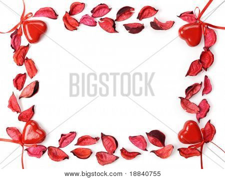 Conceptual frame made from red rose petals and hearts Valentine Day love letter background pattern Isolated over white background