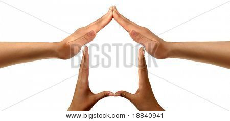 Conceptual symbold home made from black and white hands isolated over white background