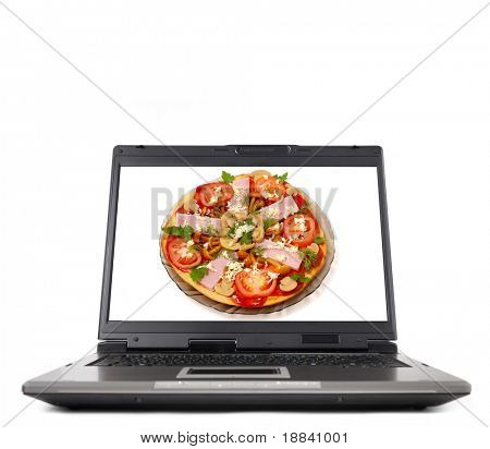 Laptop computer close-up with an appetizing pizza on its display Isolated on white background