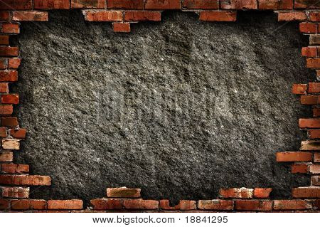 Grungy dark gray concrete wall in red brick frame conceptual background texture. Isolated with clipping path.